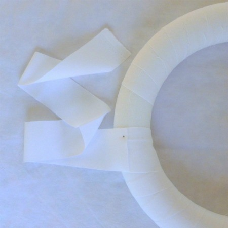 Wrap strips of white fabric around your foam wreath.