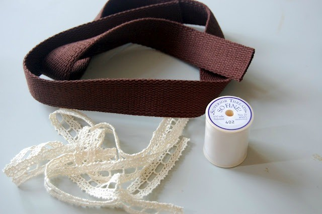 Line up your lace over the cotton webbing.