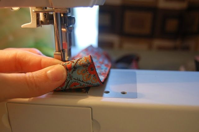 Fold the ribbon over twice, sew it down and continue along the other edge.