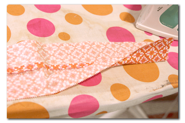 Take two strips to make a waistband. Sew right sides together and then fold it wrong sides together.